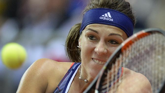 Russia's Anastasia Pavlyuchenkova returns a service to German Sabine Lisicki during their Federation Cup tennis world group semifinal match between Russia and Germany  in Sochi on April 18, 2015