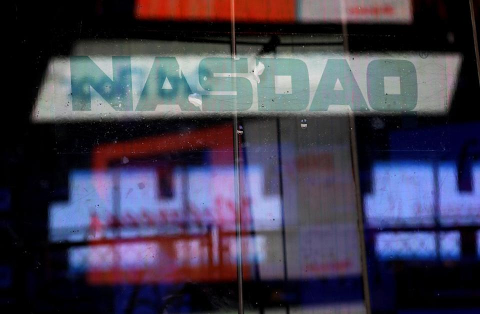 Electronic billboards are reflected in the windows of Nasdaq in New York, Thursday, Aug. 22, 2013. Nasdaq halted trading Thursday because of a technical problem, the latest glitch to affect the stock market. (AP Photo/Seth Wenig)