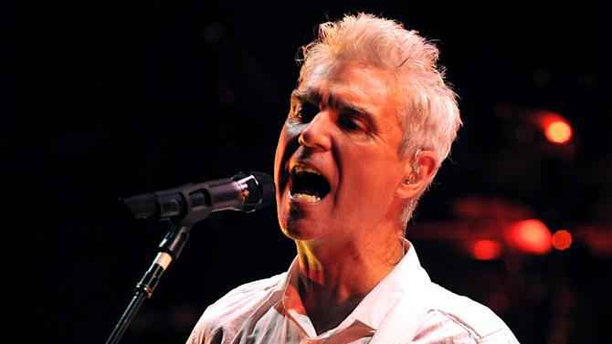 FILE - In this July 7, 2009 file photo, Scottish-American musician and artist David Byrne, formerly of the new wave band Talking Heads, performs in the Universal Hall in Macedonia's capital, Skopje. The Public Theater will offer six plays making their world premiere and two new musicals during its 2012-2013 season, including a show with songs by Byrne and Fatboy Slim. (AP Photo/Boris Grdanoski, File)