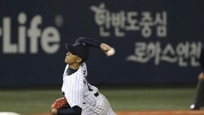 Japan's starter Satake pitches against China during a preliminary round baseball game at the Mokdong Baseball Stadium in Seoul, during the 17th Asian Games