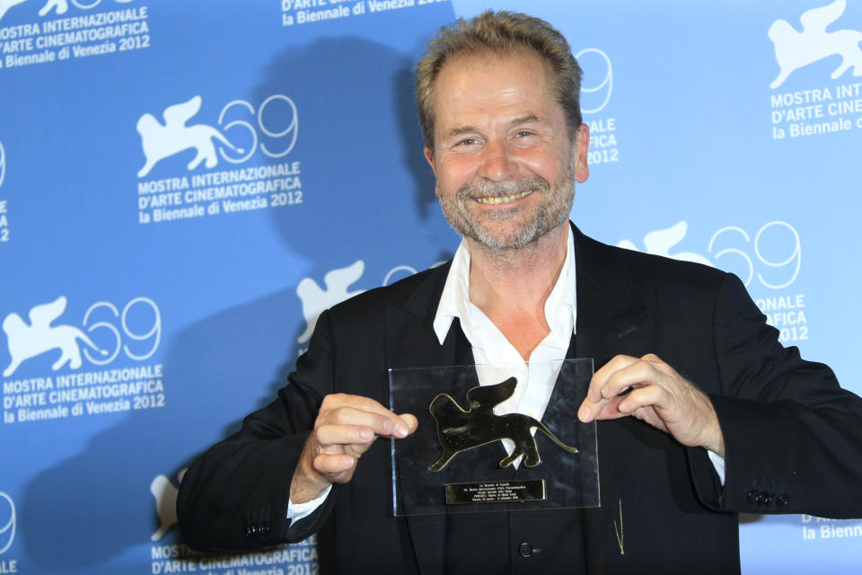 "Director Ulrich Seidl shows his Jury Special Award for his movie ""Glaube' at the awards photo call during the 69th edition of the Venice Film Festival in Venice, Italy, Saturday, Sept. 8, 2012. (AP Photo/Joel Ryan)"