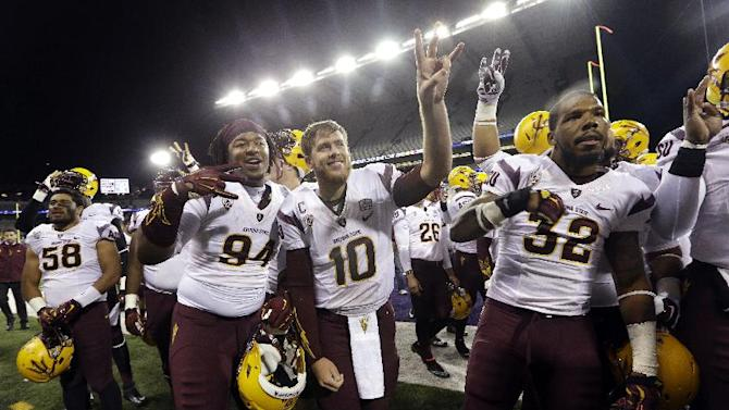 Arizona State quarterback Taylor Kelly (10) and teammates celebrate after beating Washington in an NCAA college football game Saturday, Oct. 25, 2014, in Seattle. Arizona State won 24-10