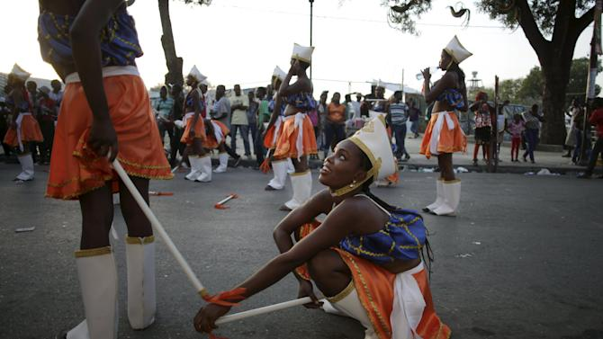 Revellers take a break during the Carnival 2016 parade in Port-au-Prince
