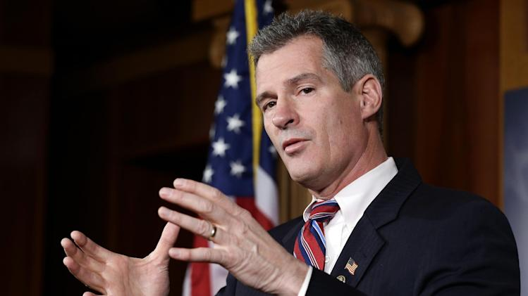 Sen. Scott Brown, R-Mass., speaks during a media availability, on Capitol Hill Tuesday, Nov. 13, 2012, in Washington. (AP Photo/Alex Brandon)