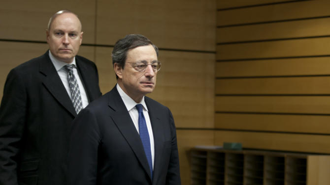 European Central Bank President Mario Draghi, right, arrives for a meeting of EU finance ministers in Brussels on Wednesday, Dec. 12, 2012. European Union finance ministers on Wednesday sought to agree on the creation of a single supervisor for banks across the 27-country bloc after France and Germany apparently patched up their differences over the issue. (AP Photo/Virginia Mayo)