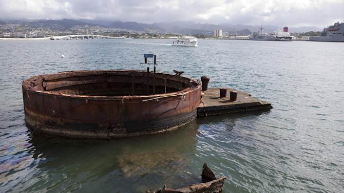 FILE - This Dec. 7, 2011 file photo shows a gun turret base from the USS Arizona in Pearl Harbor, Hawaii. This popular site at Pearl Harbor is actually a grave, a resting place for crew members who died in the Pearl Harbor attack of Dec. 7, 1941. Visitors can see it on a first-come, first-serve basis, and many do to see a significant piece of history and pay respects to those who died. (AP Photo/Marco Garcia, file)