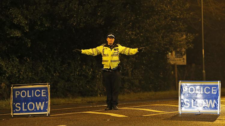 British police officers cordon off a road near a residence in Ascot, a town 40 kilometers (25 miles) west of London, Saturday, March 23, 2013. Boris Berezovsky, 67, a self-exiled and outspoken former Russian oligarch who had a bitter falling out with Russian President Vladimir Putin, was found dead Saturday in southeast England. Thames Valley police said his death was being treated as unexplained. They would not directly identify him, but when asked about him by name they read a statement saying they were investigating the death of a 67-year-old man at a property in Ascot. A mathematician turned Mercedes dealer, Berezovsky amassed his wealth during Russia's chaotic privatization of state assets in the early 1990's. The one-time Kremlin powerbroker fell out with Putin and sought political asylum in Britain in the early 2000's. He has lived in the U.K. ever since. (AP Photo/Lefteris Pitarakis)