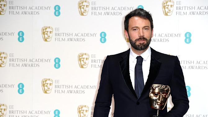 "American actor and director Ben Affleck with the award for Best Film for ""Argo,"" at the BAFTA Film Awards at the Royal Opera House on Sunday, Feb. 10, 2013, in London. (Photo by Jonathan Short/Invision/AP)"