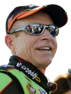 NASCAR Sprint Cup Series driver Mark Martin smiles after winning the pole for the Good Sam Club 500 auto race at the Talladega Superspeedway in Talladega, Ala., Saturday, Oct. 22, 2011. Martin took the pole with a speed of 181.367mph. (AP Photo/Terry Renna)