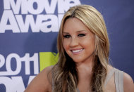 FILE - In this June 5, 2011 file photo, Amanda Bynes arrives at the MTV Movie Awards, in Los Angeles. Bynes entered a civil compromise to end a misdemeanor hit-and-run case on Thursday, Dec. 13, 2012, court records show. (AP Photo/Chris Pizzello, File)