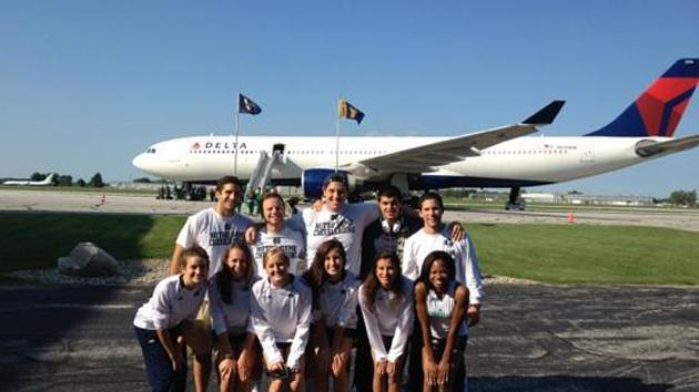 Notre Dame cheerleaders go casual to fly Delta.