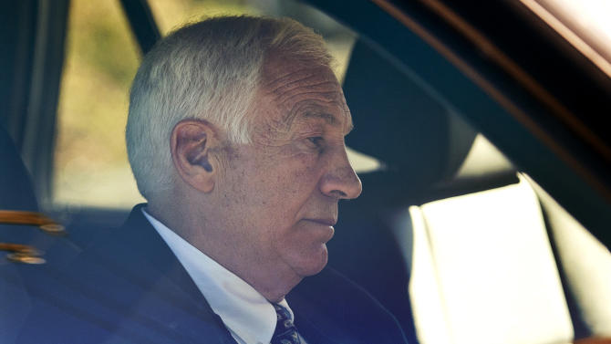 """FILE - In this Nov. 5, 2011 file photo, former Penn State football defensive coordinator Gerald """"Jerry"""" Sandusky sits in a car as he leaves the office of Centre County Magisterial District Judge Leslie A. Dutchcot in State College, Pa. Sandusky, who is charged with sexually abusing eight boys in a scandal that has rocked the university, said in an telephone interview with Bob Costas Monday night on NBC News' """"Rock Center"""" that there was no abuse and that any activities in a campus shower with a boy were just horseplay, not molestation. (AP Photo/The Patriot-News, Andy Colwell, File)"""