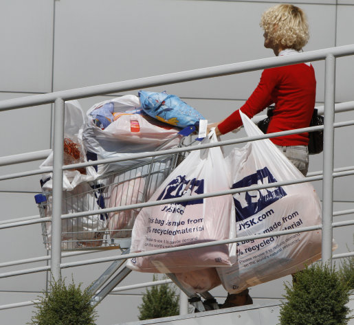 This Aug. 29, 2012 photo shows a woman pushing a shopping cart with the products purchased in the supermarket in Warsaw, Poland, Wednesday, Aug. 29, 2012. Poland, one of Europe's fast growing economies, announces second quarter gross domestic product figures. They are expected to come in around 2.9 percent year-on-year, a good showing given the troubled times but still a clear slowdown compared to the 4.3 percent growth of last year. (AP Photo/Czarek Sokolowski)