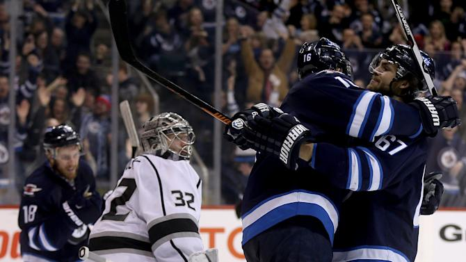 Ladd lifts Jets to 5-2 win over Kings