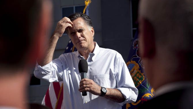 Republican presidential candidate, former Massachusetts Gov. Mitt Romney pauses while speaking on the roof of an office building in Harrisburg, Pa., Thursday, April 5, 2012. (AP Photo/Steven Senne)