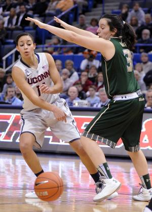 Connecticut's Bria Hartley, left, is guarded by South Florida's Laura Marcos Canedo (31) during the first half of an NCAA college basketball game in Hartford, Conn., Sunday, Jan. 26, 2014. (AP Photo/Fred Beckham)