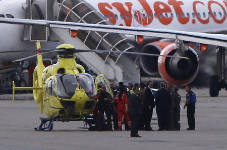 A medical helicopter with U.S. Secretary of State John Kerry arrives at Geneva airport