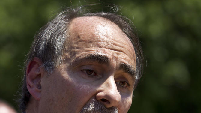 David Axelrod, a strategist for President Obama, addresses a crowd in front of the Statehouse, in Boston Thursday, May 31, 2012. Axelrod criticized former Mass. Gov. and Republican Presidential candidate Mitt Romney's record as governor of the state during his remarks. (AP Photo/Steven Senne)