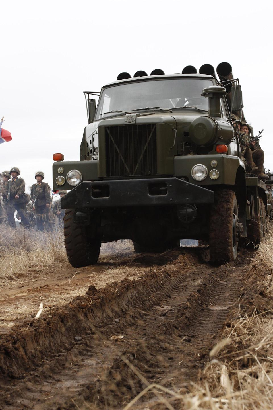 North Korean soldiers move vehicles and weapons during military exercises at a military base on North Korea's southwest coast, opposite South Korea's Baengnyeong Island Monday March 5, 2012. (AP Photo/Kim Kwang Hyon)