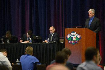 Roy Krasik, right, senior director of Major League Baseball operations, announces a selection during the Rule 5 draft at baseball's winter meetings in Lake Buena Vista, Fla., Thursday, Dec. 12, 2013