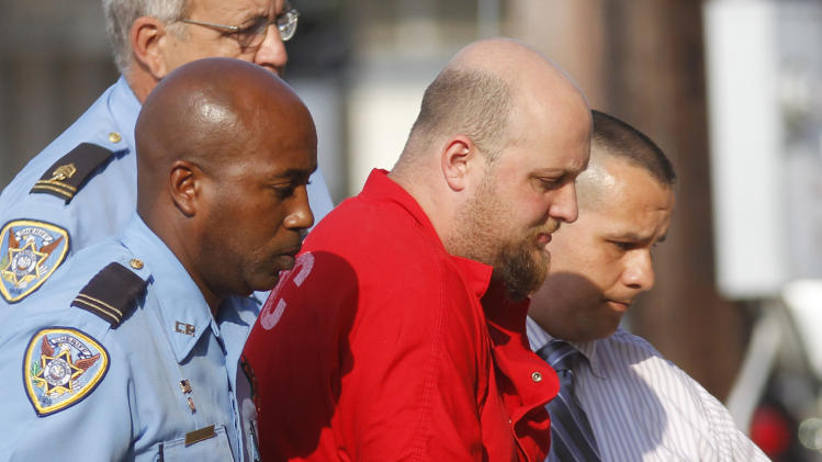 Jeremiah Lee Wright, center, 30, father of seven-year-old Jori Lirette, who was disabled and wheelchair-bound from cerebral palsy, and was found decapitated and dumped outside his home with his father sitting nearby, is transported into District Court to face murder charges in the boy's death, in Thibodaux, La., Tuesday, Aug. 16, 2011. Wright confessed to killing Jori Lirette within 30 minutes of being brought to the police station Sunday, Thibodaux Police Chief Scott Silverii said Monday. (AP Photo/Gerald Herbert)
