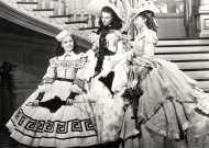 This undated image from the film &quot;Gone with the Wind&quot; provided by New Line Cinema shows, from left, Ann Rutherford, Vivien Leigh and Evelyn Keyes. Rutherford, who played Scarlett O'Hara's sister Carreen in the 1939 movie classic &quot;Gone With the Wind,&quot; died at her home in Beverly Hills, Calif. on Monday, June 11, 2012. She was 94. (AP Photo/New Line Cinema)