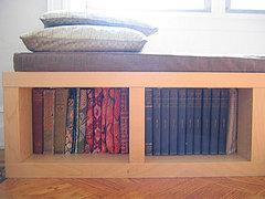 This Ikea Lack shelf, topped by a handmade cushion, proves that bookshelves can do double duty as…