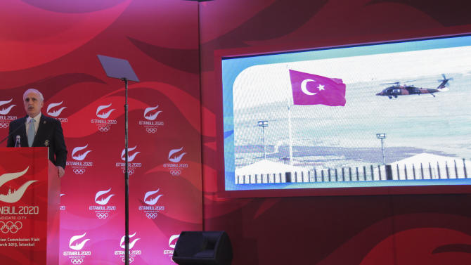 """Istanbul Governor Huseyin Avni Mutlu speaks about his city's bid to host the 2020 Olympics during a news conference in Istanbul, Turkey, Wednesday, March 27, 2013. The International Olympic Committee, IOC, vice president Craig Reedie said the IOC has an """"excellent impression"""" of the Istanbul committee's bid to host the 2020 Olympics. Reedie was speaking Wednesday as the IOC's evaluation commission wrapped-up a four-day tour to assess Istanbul's ability to host the 2020 Olympic Games. Istanbul is competing against Madrid and Tokyo. (AP Photo)"""