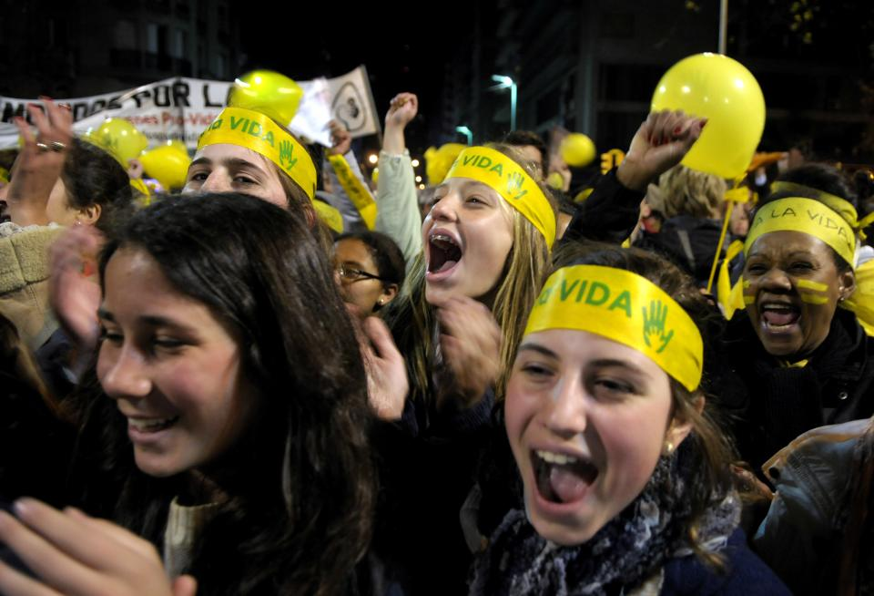 "People demonstrate against abortion legalization in downtown Montevideo, Uruguay, Monday, Sept. 24, 2012. Demonstrators protested the day before a congressional bill legalizing abortion is voted on. The headbands read in Spanish ""yes to life."" (AP Photo/Matilde Campodonico)"