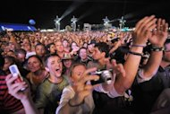 Fans attend the Rock in Rio festival in Spain in 2008. One of the world's biggest festivals, Rock in Rio opens in recession-hit Spain this week vowing to defy the misery of austerity with rock, and food