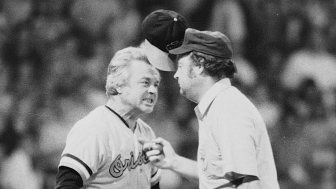 "FILE - In this July 13, 1974 file photo, Baltimore Orioles manager Earl Weaver literally ""flips his lid"" as he protests a call by home plate umpire Marty Springstead during a baseball game against the Chicago White Sox in Chicago. Weaver, the fiery Hall of Fame manager who won 1,480 games with the Baltimore Orioles, has died, the team announced Saturday, Jan. 19, 2013. He was 82. (AP Photo/File)"