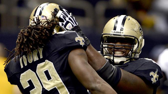 New Orleans Saints running back Chris Ivory (29) celebrates his touchdown with guard Ben Grubbs during the first half of an NFL football game against the Philadelphia Eagles at Mercedes-Benz Superdome in New Orleans, Monday, Nov. 5, 2012. (AP Photo/Bill Feig)