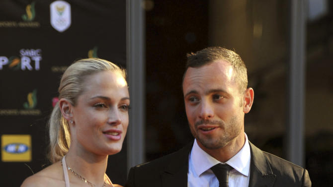 In this Nov. 4,  2012 photo, South African Olympic athlete Oscar Pistorius and Reeva Steenkamp, believed to be his girlfriend, at an awards ceremony, in Johannesburg, South Africa.  Olympic athlete Oscar Pistorius was taken into custody and was expected to appear in court Thursday, Feb. 14, 2013,  after a 30-year-old woman who was believed to be his girlfriend was shot dead at his home in South Africa's capital, Pretoria. (AP Photo/Lucky Nxumalo-Citypress) SOUTH AFRICA OUT