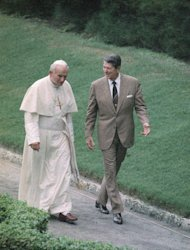 FILE - This Sept. 10, 1987 file photo shows President Ronald Reagan and Pope John Paul II talking as they walk during a visit by the pope to the United States. Polish officials have unveiled a statue of former President Ronald Reagan and John Paul II, honoring two men whom many Poles credit with helping to topple communism in Gdansk on Saturday July 14, 2012. The bronze statue, is a slightly larger than life rendering of the two late leaders. It is based on this Associated Press photograph taken in 1987 on John Paul's second pontifical visit to the U.S. (AP Photo/Scott Stewart, File)