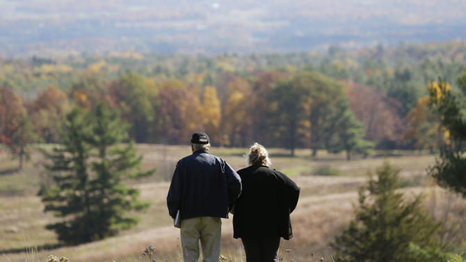 Jerry and Deb Treacy, of Shelton, Conn., view the scene near the visitor's center at Saratoga National Historical Park on Thursday, Oct. 17, 2013, in Stillwater, N.Y. The park, site of one of history's most important battles, has reopened now that a temporary truce has been reached in Washington over the federal budget battle. (AP Photo/Mike Groll)