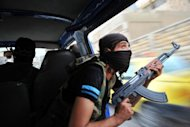 Syrian rebels hunt for snipers after attacking the municipality building in the city center of Selehattin, near Aleppo, during fights between rebels and Syrian troops. Syria admitted on Monday it has chemical weapons and warned of using them if attacked, though not against its own civilians, as regime troops reclaimed most of Damascus after a week of heavy clashes