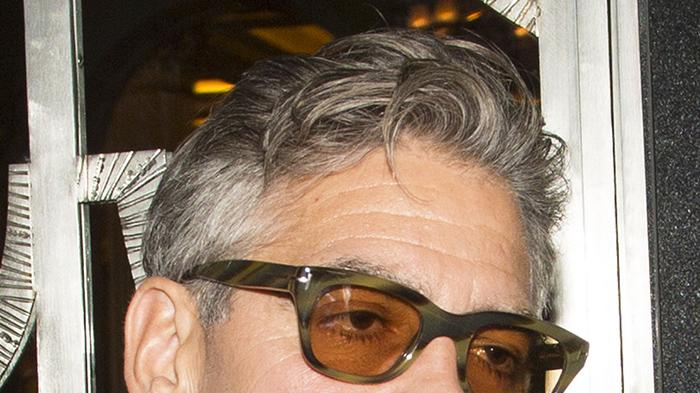 Silver Fox George Clooney parties and dances with a mystery brunette at Loulou's nightclub in Mayfair before heading back to his Hotel in London