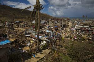 In this Thursday, Nov. 14, 2013 photo, Typhoon Haiyan …