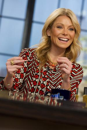"""In this Jan. 24, 2012 photo, Kelly Ripa tapes an episode of """"Live! with Kelly,"""" in New York. The producers of """"Live! With Kelly"""" say a new co-host will be revealed on the show Sept. 4. Ripa that morning will officially announce her new partner as he or she joins her on stage. By then, Ripa will have welcomed 59 guest co-hosts since Regis Philbin retired from the show last November, Disney-ABC Domestic Television said Monday, Aug. 20, 2012. The chosen one will come for that large pack, the company said. (AP Photo/Charles Sykes)"""