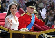 FILE - In this Friday April 29, 2011 file photo Britain's Prince William and his bride Kate, Duchess of Cambridge, leave Westminster Abbey, London, following their wedding. The Duke and Duchess of Cambridge are very pleased to announce that the Duchess of Cambridge is expecting a baby, St James's Palace officially announced Monday Dec. 3, 2012. (AP Photo/Tom Hevezi, File)