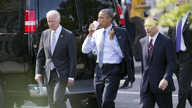 President Barack Obama, center, and Vice President Joe Biden, left, walk with Procter and Gamble executive Robert McDonald, Obama's nominee as the next Veterans Affairs secretary, from the Department of Veterans Affairs back to the White House in Washington, Monday, June 30, 2014. If confirmed by the Senate, McDonald would succeed Eric Shinseki, the retired four-star general who resigned last month as the scope of the issues at veterans' hospitals became apparent. (AP Photo/Manuel Balce Ceneta)