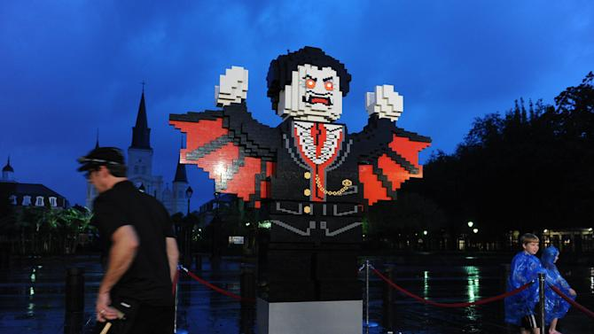 LEGO builders complete the giant vampire figure at the LEGO Halloween-themed community build on Sunday Sept 30, 2012, in New Orleans. (Photo by Cheryl Gerber/Invision for LEGO/AP Images)