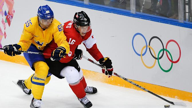 Canada rules rink, a flame dies, an Olympics ends