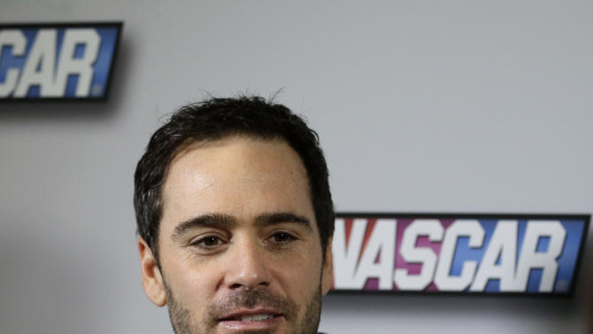 Auto racing driver Jimmie Johnson talks with reporters during NASCAR media day at Daytona International Speedway, Thursday, Feb. 14, 2013, in Daytona Beach, Fla. (AP Photo/John Raoux)