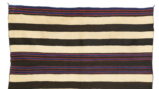 FILE - This undated file photo provided by Sotheby's New York shows a  Navajo man's wearing blanket from the collection of Andy Williams. Williams' eclectic art collection has brought $46 million at a New York City auction on Wednesday May 15, 2013. (AP Photo/Sotheby's, File)