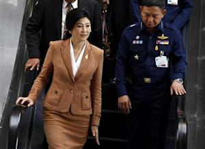 Thailand's Prime Minister Yingluck Shinawatra leaves the Royal Thai Air Force Headquarters after a defense meeting in Bangkok March 4, 2014. REUTERS/Chaiwat Subprasom