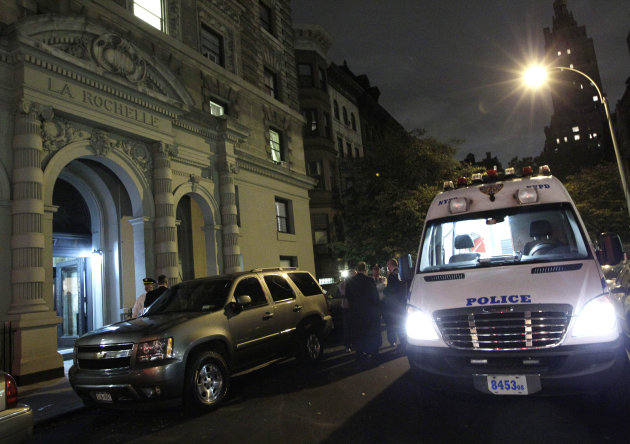 A police crime scene vehicle is parked in front of the luxury Manhattan apartment building where police say a nanny stabbed two small children to death in a bathtub and then stabbed herself in New York, Thursday, Oct. 25, 2012. Police say the children&#39;s mother found the scene after returning home with another child. (AP Photo/Kathy Willens)