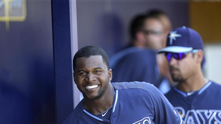 Tampa Bay Rays right fielder Jeremy Moore, right, is greeted at the dugout after hitting a two-run homer in the seventh inning of an exhibition baseball game against the Minnesota Twins in Port Charlotte, Fla., Tuesday, March 11, 2014. The Rays won 7-1. (AP Photo/Gerald Herbert)