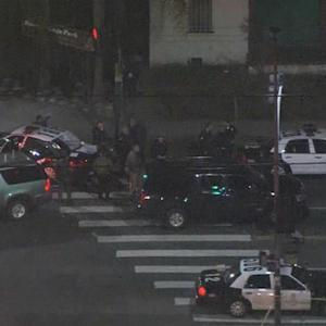 Massive search after suspects fire on LAPD patrol car