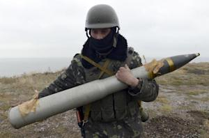 A Ukrainian serviceman prepares to load a shell into …